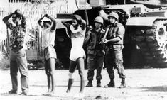 In the shadow of an American tank, two U. soldiers stand guard over three Grenadian prisoners. President Ronald Reagan ordered the invasion of Grenada in 1983 in order to oust its Marxist government. AP/WIDE WORLD PHOTOS Invasion Of Grenada, Democratic Election, Military Intervention, Southern Caribbean, President Ronald Reagan, Military Coup, The Guardian, Troops, United States