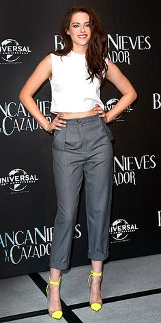 KRISTEN STEWART  Trading in ultra-glam gowns for a more casual look at the Mexico City stop of the Snow White and the Huntsman promo tour, the actress is clearly happy with her choice of a Marios Schwab top, Vivienne Westwood pants, BaubleBar and Anita Ko jewels and neon-tipped pumps.