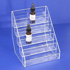 This acrylic E-Cig Liquid Bottle stand is ideal to organize your products. Also can be use for other merchandise Used Store Fixtures, E Cig Liquid, Gondola Shelving, Glass Showcase, Glass Countertops, Bottle Display, Glass Cube, Slat Wall, Acrylic Display