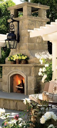 Gorgeous Outdoor Fireplace, but the lantern looks awkward hanging in there.