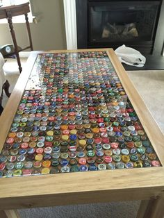 Customizable inlaid coffee table. Ideal for displaying beer caps or any collectable item. The inlay can accommodate just about any item you wish to place under the glass. Built by hand in North Carolina with beautiful poplar wood. The table can also be customized to a variety of lengths and sizes. Ive suggested a few different sizes with accompanying prices:  18 x 18 bedside or couch-side table 24 x 48 coffee table 36 x 36 square kitchen table 36 x 60 kitchen banquet table  The base height…