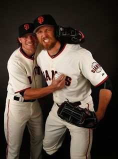 Pitcher Jake Peavy #22 and Hunter Pence #8 of the San Francisco Giants pose for a portrait during spring training photo day at Scottsdale Stadium on February 28, 2016 in Scottsdale, Arizona.