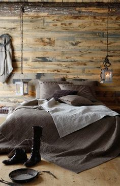 Beautiful color #Grey bedding.  Simple rustic Bedroom.  Love the hanging lantern and aged wood plank wall.