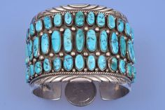 Old pawn Navajo cuff with three rows of Sleeping Beauty turquoise   High Plains Jewelry