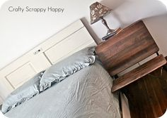 Love the vintage school desk as a side table and place to sit.