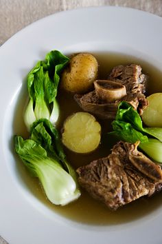 "Beef Short Ribs in Broth or ""Nilagang Baka""-  It's interesting to note that in a country like the Philippines, this dish transcends social class. It has graced the tables of both the wealthy and the not-so-wealthy, differing only in the quality of meat used. I can imagine this type of soup being perfect for a rustic meal at a farm, where ingredients are fresh! So, get your steamed white rice or crusty bread ready…"
