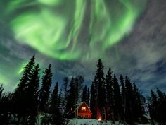 See the Northern Lights from North Pole, Alaska! You can even have them in your backyard in this cozy cabin.