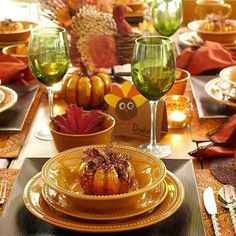 pretty mustard-colored dinnerware looks great on this thanksgiving table