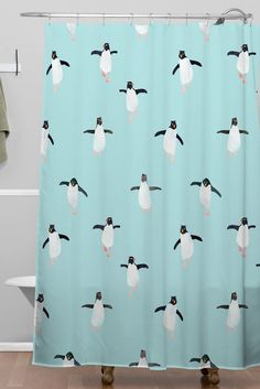 Hello Sayang Penguin Parade Shower Curtain | DENY Designs Home Accessories