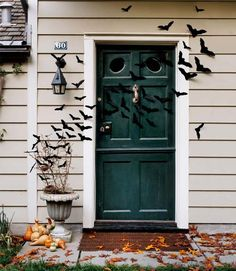 Bat-Filled Front Door - These felt bats are easy to make and ensure your house looks extra spooky. All you need to do is trace a bat shape onto a piece of felt and cut it out. Repeat until you have a swarm of them. Read more: Halloween Craft Ideas for Kids - Halloween Craft Projects - Country Living