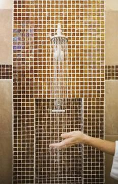 Tile is a far more durable substance than fiberglass for showers.