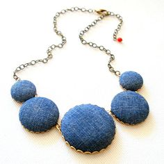 This unique and dramatic statement necklace is very lightweight and comfortable covered with recycled Denim cotton fabric ( cut out and throughly washed from recycled jeans). The cabs are set in gold