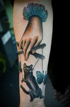 439774740819d This cute kitty was tattooed by Silje Roe Hagland. #InkedMagazine #puppet # cat
