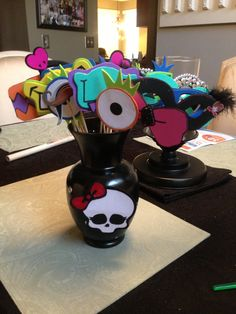 Monster High party DIY vase spray painted vase with glued on sequence. got the skull off a google search and put it on foam