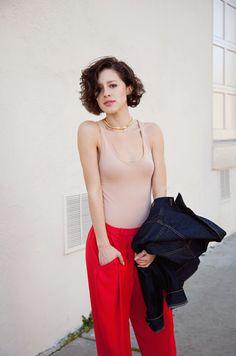 Diane Von Furstenburg trousers, American Apparel cotton bodysuit, denim jacket, and vintage jewelry.