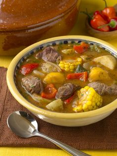 Puerto Rican Sancocho Soup, hearty and delicious with a side bowl of White Rice. That's how us Puerto Ricans do!