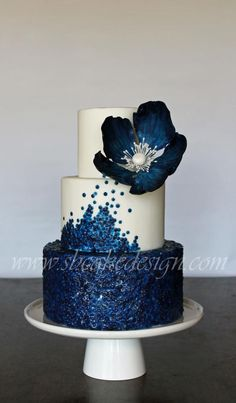 Stunning cake with edible blue sequins and flower - #navy #white #wedding_cake