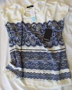 I like the style of this shirt.  I'd prefer a different color since I'm not a navy blue fan, but if I had a cute pair of jeans, it would be OK.  I'd also prefer short sleeves