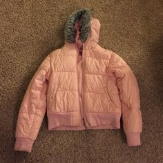 Southpole Medium Pink puffy jacket Southpole Medium Pink puffy jacket with gray polyester fur trim. Filler 38% down, 63% feather. Needs a little cleaning, but otherwise good condition. South Pole Jackets & Coats Puffers