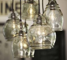 Paxton Glass 8-Light Pendant   Pottery Barn  Believe they are using standard clear fan light style bulbs.  Hate the expense of deco filament bulbs!