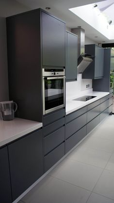 Modern handle-less grey matt painted bespoke kitchen with white Silestone tops in Kingston Surrey. Designed & fitted by . Kitchen Inspirations, Grey Kitchens, Dark Grey Kitchen, Bespoke Kitchens, Grey Kitchen Designs, Kitchen Remodel, Contemporary Kitchen, Kitchen Remodel Small, Kitchen Floor Tile