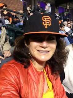 Dr. Kathy Fields keeps her eyes, scalp and forehead protected on and off the field with her favorite baseball team's hat. #GoGiants #RFSkintervention
