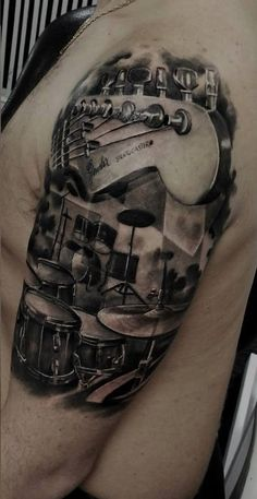Tattoo. Drums and guitar.