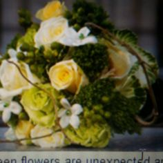 I want flowers like this with white calla Lilies instead of yellow roses