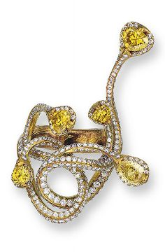 A STYLISH COLOURED DIAMOND AND DIAMOND RING, BY WALLACE CHAN Of stylized design, each terminal set with a pear or heart-shaped yellow diamond, overlaying brilliant-cut diamonds, each joined to the brilliant-cut diamond interlaced scrolls extending to the textured band, mounted in yellow titanium.