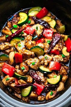 Skinny Slow Cooker Kung Pao Chicken coated in a sweet & spicy sauce with tender vegetables & crunchy cashews. Skip the takeout, this is so much better!