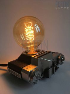 Handmade lamp made from a vintage Zenit-E camera. It comes with a 180 cm long textil cord. Bulb is not included (E27, max 40w, 220V). Dimensions: 28cm x 21 cm x 6cm (approximately).  Can be installed with UK or EU plug.  More lamps: www.facebook.com/fotonlamps