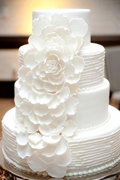White three tier wedding cake with peony flowers