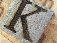 Custom engraved letter or number onto weathered wood. Choose your own letter, number, or symbol. Pick from a variety of available fonts. We can more