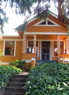 Lighter Orange Exterior, White/cream Trim, Blue Door And Porch, Red/dark  Orange Details
