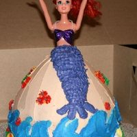 "Mermaid Ariel cake made with Wilton Wonder Mold and an 8"" round base. WASC with all buttercream frosting except the doll itself and her bikini top. Don't mind her hair...trying to keep it out of the way until the customer picks it up ;)  See..."