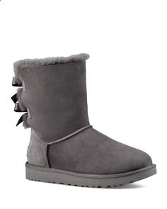 Two adorable bows update Uggs signature Bailey boot of heavenly-soft  sheepskin.  58765fd14