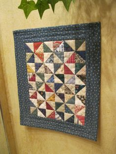 "Miniature Pin Wheel quilt...each half square triangle is 1"" sq."
