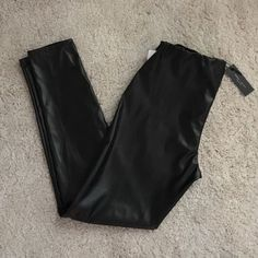 faux leather leggings  Brand new, never worn. Making room in my closets. Smoke and pet free home. If you have any questions feel free to ask. Romeo & Juliet Couture Pants Leggings