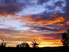 An August sunrise in between the rains. We had a fabulous summer up here!! :)