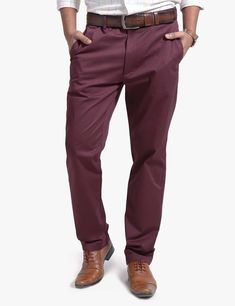These slim fit chino pants are cut from a fine cotton stretch fabric. It features belted waistband with button closure at centre front and back pockets, contrast printed pocket liners, and a tailored cut which distinguishes it from the average chino. The fabric is remarkably soft for uncompromising comfort #olgyn #malefashion #mesnoutfits #mensstyle #mensfashion #fashionformen #summer2018 #summerfashion #usa #chino #chinopants #menswear Mens Chino Pants, Denim Pants, Denim Outfit, Wholesale Clothing, Stretch Fabric, Centre, Cotton Fabric, Contrast