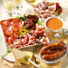 Enjoy a cornucopia of our favorite foods from Spain! We have gathered a sampler of our most delectable items, each a customer favorite, for you to share with family and friends.    First let us tempt you with some incredible cured meats. Thinly sliced Serrano and Ibérico hams are unlike any ham in the world. Best served at room temperature with good crusty bread. Cured chorizo sausage by Palacios has a smoky, meaty flavor and is also ready to slice and serve. And our artisan cooking chorizo…