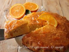 Pan d arancio ricetta originale siciliana soffice e golosa.Una deliziosa torta all'arancia frullata con buccia e senza burro ricoperta da tanta marmellata