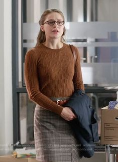 Kara's brown cable knit sweater and plaid skirt on Supergirl.  Outfit Details: https://wornontv.net/67139/ #Supergirl