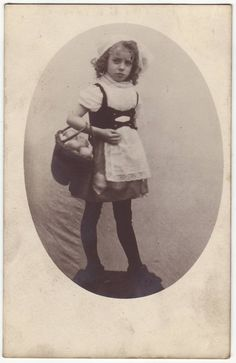 Victorian little girl in folklore outfit.  Antique photo postcard, early 1900's.