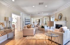 Transitional Living Room with stone fireplace, Maple - Natural 3 1/4 in. Solid Hardwood Plank, Carpet, Crown molding