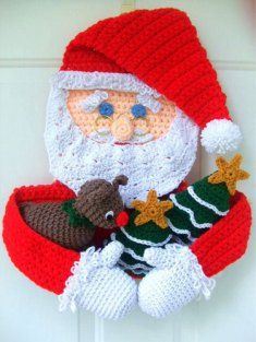Santa can hang on a door or a wall and greet all of your holiday visitors!!! He is holding Christmas trees and a little reindeer. You can make several reindeer for craft fairs or for all of the little ones on your list. Santa is made with 2 strands of yarn and works up very quickly!!!