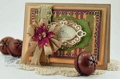 11-21-12.  RECIPE:  Stamps:Our Daily Bread Designs- Chickadee Ornament  Paper: Kraft Paper, Bazzill, Coredinations, K & Co.  Ink: Amuse French Roast, Brushed Corduroy Distress Ink  Accessories: Spellbinders™ Resplendent Rectangles,Spellbinders™ Labels Twenty Five,Spellbinders™ Floral Ovals,Spellbinders™ Fancy Tags Two,Hug Snug Seam Binding, Recollections Pearls, Michael's Poinsettia, Trim