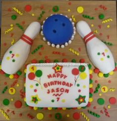 Homemade Bowling Birthday Cake: I made this bowling birthday cake for my son's 7th birthday party. This was our first cake that we made.   I used (2) 2 layer 9x13 cakes and a sports ball