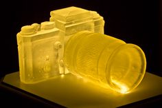 Cast glass 35 mm camera, Led Light underneath and wooden box