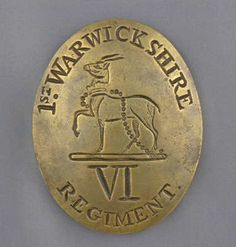 "This is the cross belt plate of the 6th Regiment of Foot (1st Warwickshire). It is oval shaped with ""1st. Warwickshire"" engraved around the edge. In the centre is an antelope with one foreleg raised and a chain at the neck falling to the ground. Just below this is engraved ""VI REGIMENT"". There are three plugs on the reverse side. Image courtesy of the Niagara Falls History Museum"